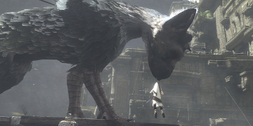 The same dog-like creature, picking up the player's character with it's mouth