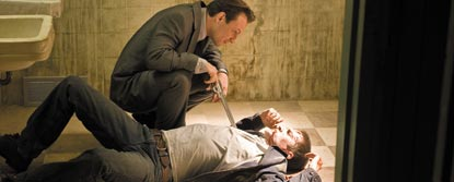 Jimmy Dolan Pointing A Gun At A Man Lying On The Floor