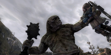 A large, troll-like creature, holding up a person in one hand