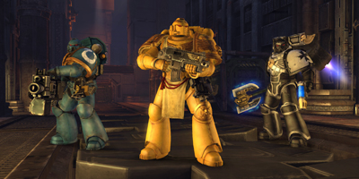 Three Space Marines, stood together, to show the differences in chapters