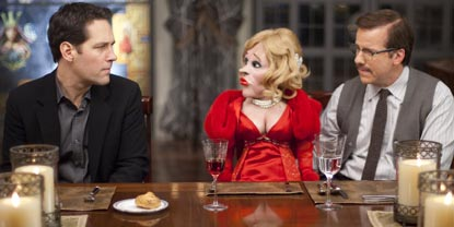 Tim Played By Paul Rudd Sat At A Table Next To A Man With A Female Ventriloquist Doll