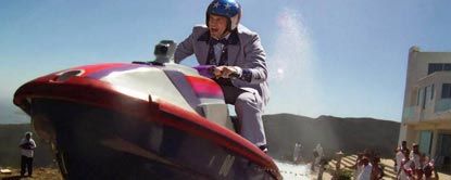 Johnny Knoxville In A suit And Helmet Sat On A Jet Ski