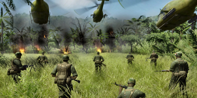Infantry advance as helicopters fly low overhead