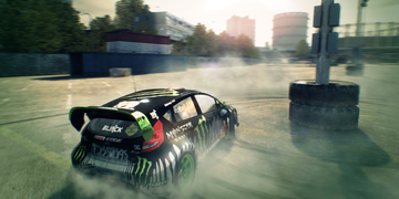 Ken Block's famous Ford Fiesta doing doughnuts round some tyres