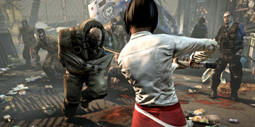 A female character threatens a large zombie with a sword