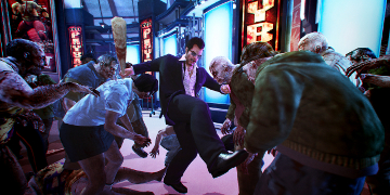 The player, kicking and punching their way through a mob of zombies