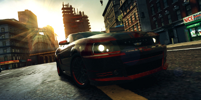 A red and black muscle car, speeding through the city