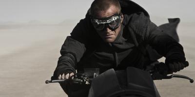 Priest Riding A Motorbike