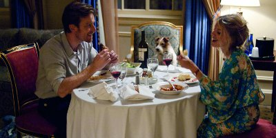 Oliver Fields Sat At A Dinner Table With Anna And A Dog