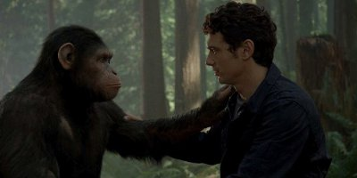 Caesar The Chimpanzee And Will Rodman Played By James Franco, With Their Hands On Each Others Shoulder