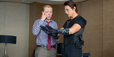 Tom Cruise and Simon Pegg Looking at Gloves
