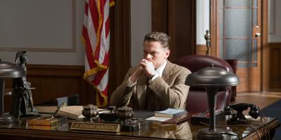 Still of Leonardo DiCaprio Sat at Desk