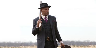 Samuel L. Jackson Holding Shotgun