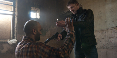 Sean Bean Pointing Gun and Holding Lighter Up at Terrorist