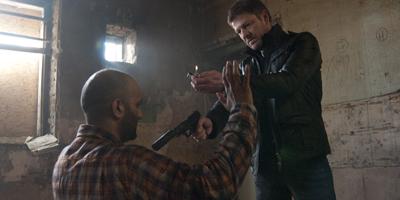 Sean Bean Pointing Gun and Holding Lighter Up at Terrorist