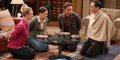 Penny, Amy, Sheldon and Leonard Gathered around a table