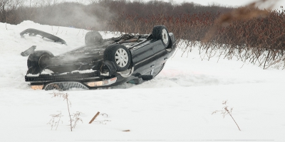 Car Upside Down in Snow