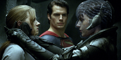 Woman clutching Woman with Man of Steel in Background