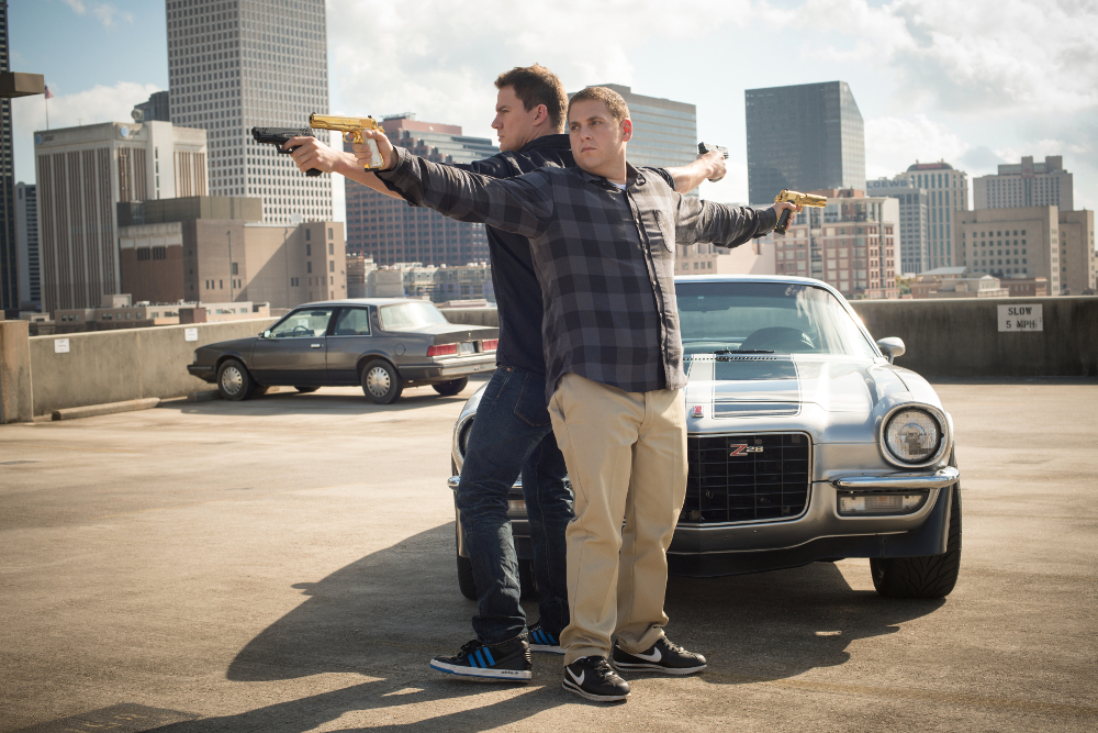 Schmidt and Jenko holding guns