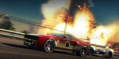 A red muscle car, racing a white super-car, as they speed past a large explosion