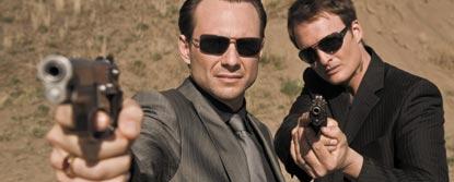 Two Men Aiming Guns