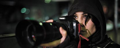 Harriet Vanger Holding A Camera With Her Hood Up