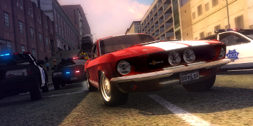 A red muscle car, bravely fighting off three police cars