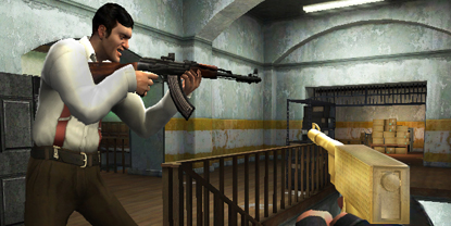 The player, with the golden gun, following somebody with an automatic rifle through a building