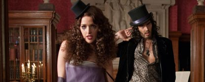 Aldous Snow Wearing A Top Hat With His Little Finger In His Ear And Jackie Q Wearing A Small Top Hat