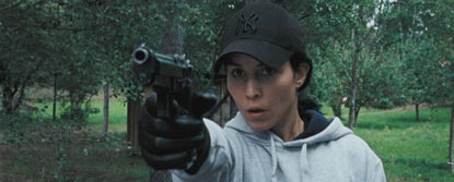 Noomi Rapace As Lisbeth Salander Aiming A Gun