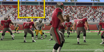 A player in red, retreating and preparing himself to throw the ball