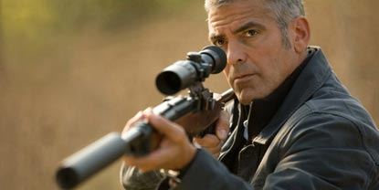 Jack Played By George Clooney Aiming A Rifle