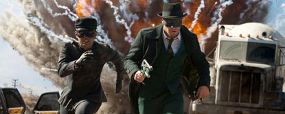 The Green Hornet And Kato Running Away From A Big Explosion