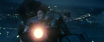 Hagrid And Harry On A Flying Motoercycle With Sidecar At Night