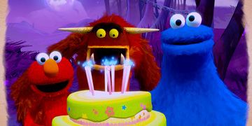 Elmo, Seamus and the cookie monster, with a birthday cake