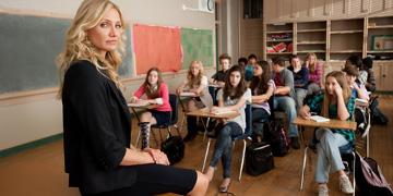 Teacher Elizabeth Hasley Sat On Her Desk Infront Of Her Pupils