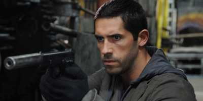 Scott Adkins As Rowland Flint Aiming At Gun
