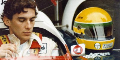 Ayrton Senna Sat In His Car With His Helmet Next To Him