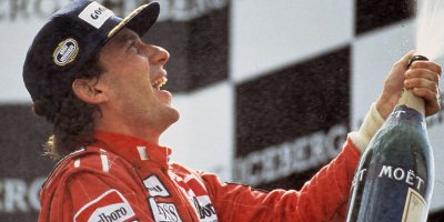 Ayrton Senna Celebrating With A Large Bottle Of Champagne