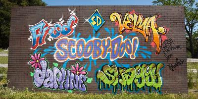 Graffiti Writing On A Wall