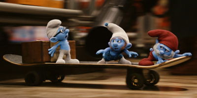 Papa Smurf, Brainy And Gutsy On A Skateboard With A Box