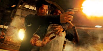man shooting a gun, holding a man as hostage