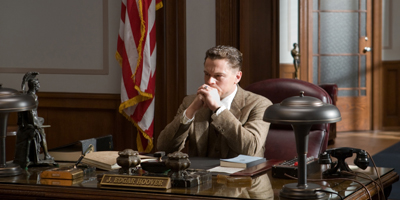 Still of Leonardo DiCaprio Sat at Desk