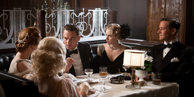 Still of Leonardo DiCaprio Sat at Table with Friends