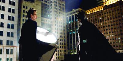Christian Bale and Gary Oldman Stood Next to Batman Light