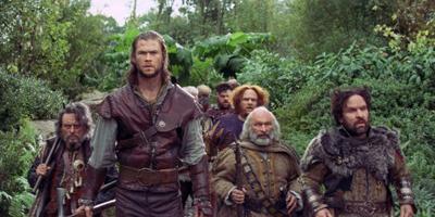 Still of Chris Hemsworth with the Seven Dwarfs