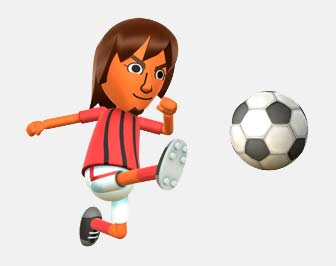 long haired lad kicking a football in a red and black striped shirt