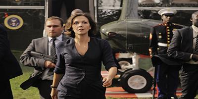 Maggie Gyllenhaal walking off a plane