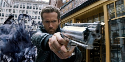 Ryan Reynolds Aiming Down Gun