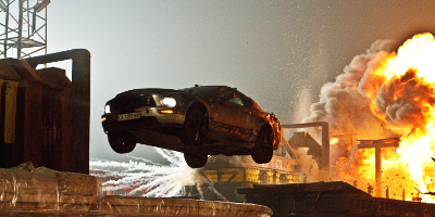 Car in the Air and Explosion in the Background
